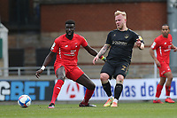 Marcel Hilßner of Oldham Athletic and Ousseynou Cisse of Leyton Orient during Leyton Orient vs Oldham Athletic, Sky Bet EFL League 2 Football at The Breyer Group Stadium on 27th March 2021