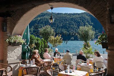 Switzerland, Ticino, Morcote at Lago Lugano: cafes and restaurants at seaside promenade   Schweiz, Tessin, Morcote am Luganer See: Cafes und Restaurants direkt am See