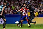 Angel Correa (c) of Atletico de Madrid fights for the ball with Tiemoue Bakayoko (r) and Cesc Fabregas of Chelsea FC during the UEFA Champions League 2017-18 match between Atletico de Madrid and Chelsea FC at the Wanda Metropolitano on 27 September 2017, in Madrid, Spain. Photo by Diego Gonzalez / Power Sport Images