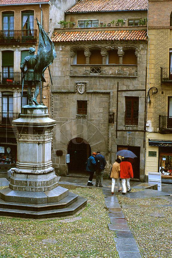 Spain, Segovia. In the old city center; shops, two couples, umbrella. Segovia Castilla Y Leon Spain.