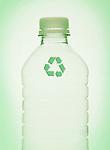 Recycling symbol on plastic bottle, studio shot
