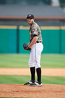 Arkansas Travelers relief pitcher Austin Kubitza (6) gets ready to deliver a pitch during a game against the Frisco RoughRiders on May 28, 2017 at Dickey-Stephens Park in Little Rock, Arkansas.  Arkansas defeated Frisco 17-3.  (Mike Janes/Four Seam Images)