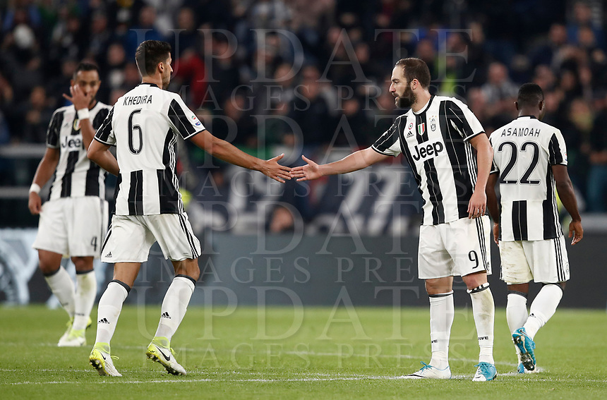 Calcio, Serie A: Torino, Juventus Stadium, 6 maggio 2017. <br /> Juventus' Gonzalo Higuain (r) celebrates with his teammate Sami Kedhira (l) after scoring during the Italian Serie A football match between Juventus and Torino at Torino's Juventus stadium, May 6, 2017.<br /> UPDATE IMAGES PRESS/Isabella Bonotto