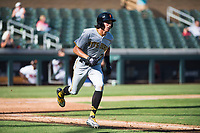 Surprise Saguaros shortstop Cole Tucker (2), of the Pittsburgh Pirates organization, runs to first base during an Arizona Fall League game against the Salt River Rafters at Salt River Fields at Talking Stick on November 5, 2018 in Scottsdale, Arizona. Salt River defeated Surprise 4-3 . (Zachary Lucy/Four Seam Images)