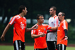 GUANGZHOU, GUANGDONG - JULY 26:  Mario Mandzukic, Franck Ribery and Xherdan Shaqiri of Bayern Munich during a training session ahead the friendly match against VfL Wolfsburg as part of the Audi Football Summit 2012 on July 26, 2012 at the Tianhe Sports Stadium in Guangzhou, China. Photo by Victor Fraile / The Power of Sport Images