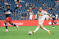 FOXBOROUGH, MA - MAY 22: Gustavo Bou #7 of New England Revolution passes the ball in front of the New England Revolution goal during a game between New York Red Bulls and New England Revolution at Gillette Stadium on May 22, 2021 in Foxborough, Massachusetts.