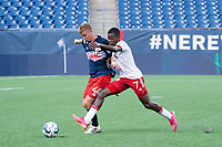 FOXBOROUGH, MA - JUNE 26: Sean O'Hearn #40 of the New England Revolution and Bernard Kamungo #7 of North Texas SC battle for the ball during a game between North Texas SC and New England Revolution II at Gillette Stadium on June 26, 2021 in Foxborough, Massachusetts.