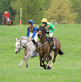 Mischief (gray) and Chess Board duel to the last jump in the Glenwood Hurdle at Middleburg.