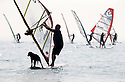 07/09/14 <br /> <br /> Black Lab, Roxy's doggy paddle may well have helped Gary Connell (47) to fourth place in the North Cup as warm weather and almost windless conditions made for slow racing at The National Watersports Festival on Hayling Island, <br /> <br /> All Rights Reserved - F Stop Press.  www.fstoppress.com. Tel: +44 (0)1335 300098