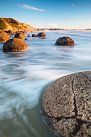 Sunrise on beach with Moeraki Boulders, Coastal Otago, East Coast, New Zealand, NZ