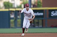 Arkansas infielder Brady Slavens (17) forces an out, Monday, June 7, 2021 in the seventh inning of the NCAA Fayetteville Regional at Baum-Walker Stadium in Fayetteville. Check out nwaonline.com/210608Daily/ for today's photo gallery. <br /> (NWA Democrat-Gazette/Charlie Kaijo)