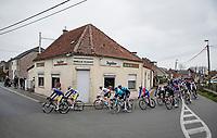 """Passing by the """"Fast Escape"""" bar<br /> <br /> 105th Ronde van Vlaanderen 2021 (MEN1.UWT)<br /> <br /> 1 day race from Antwerp to Oudenaarde (BEL/264km) <br /> <br /> ©kramon"""