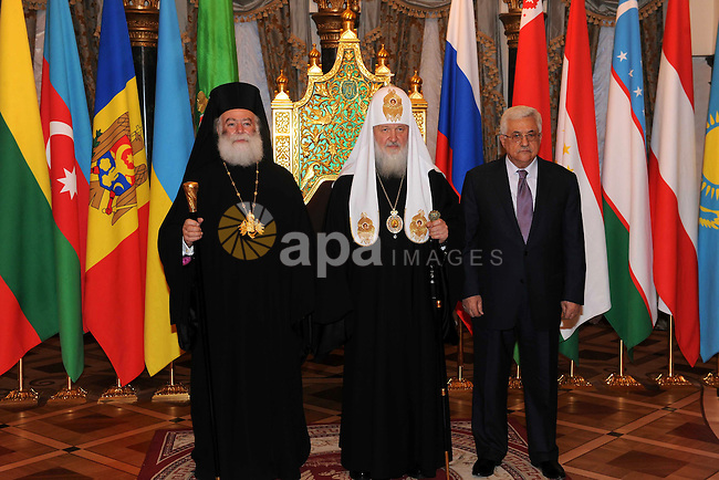 Palestinian President Mahmoud Abbas (Abu Mazen) receives the award of the late Alexei II from the Patriarch of Moscow and all Russia Patriarch Kirill I, in Moscow, on Jan. 21, 2012.  Photo by Thaer Ganaim