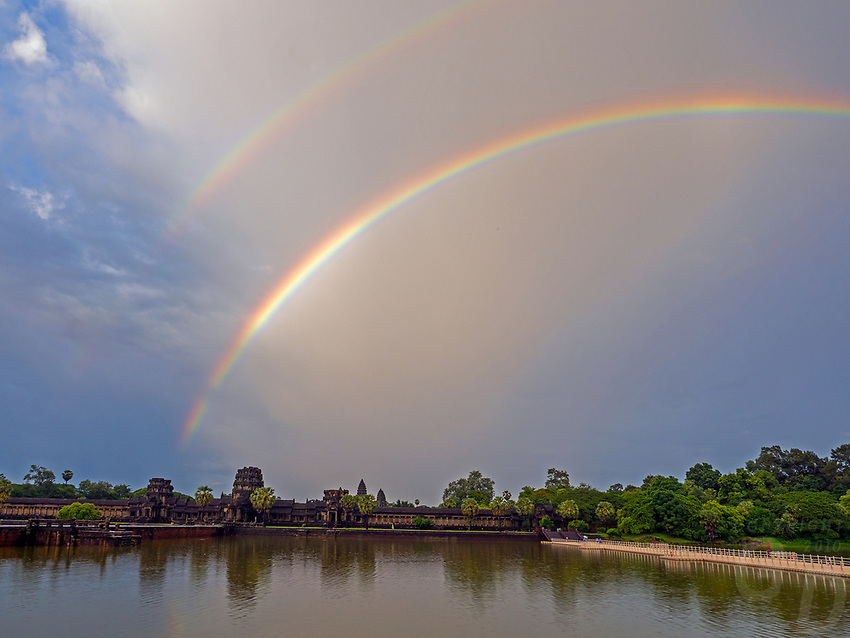 A rare Rainbow over Angkor Wat; a World Heritage Site in Cambodia and the ever changing Weather during the Monsoon Season.