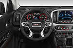 Car pictures of steering wheel view of a 2015 GMC Canyon SLT Crew Cab SWB 4 Door Truck Steering Wheel