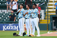 Bradenton Marauders first baseman Ernny Ordonez (14), pitcher Jared Jones (37), and third baseman Alexander Mojica (28) during the national anthem before a game against the Daytona Tortugas on June 12, 2021 at LECOM Park in Bradenton, Florida.  (Mike Janes/Four Seam Images)