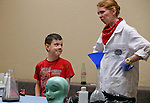 Logan Williams, 6, helps Radioactive Rachel with an experiment during the Mad Science program at the Carson City Library, in Carson City, Nev., on Tuesday, July 15, 2014.<br />