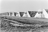 Usa. Utah. Tooele county. Deseret chemical depot. Earth covered igloos which provides secure storage for the weapons near the incinerating plant. Tooele chemical agent disposal facility (TOCDF). Program for destruction of chemical weapons and agent. Deseret chemical depot is distant 100 km from Salt Lake City. The Deseret Chemical Depot is one of eight Army installations in the U.S. that currently store chemical weapons. The weapons originally stored at the depot consisted of various munitions and ton containers, containing GB and VX nerve agents or H, HD, and HT blister agent. The Tooele Chemical Agent Disposal Facility is designed for the sole purpose of destroying the chemical weapons stockpile located at the depot. © 1998 Didier Ruef