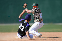 Slippery Rock infielder Jordan Faretta (11) attempts to tag out Connor Petschke (23) sliding in during a game against Kentucky Wesleyan College at Jack Russell Stadium on March 14, 2014 in Clearwater, Florida.  Slippery Rock defeated Kentucky Wesleyan 18-13.  (Mike Janes/Four Seam Images)