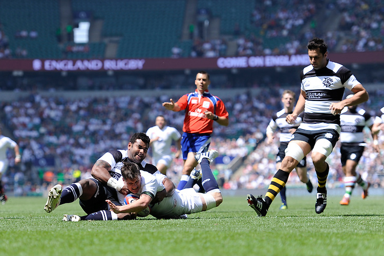 Freddie Burns of England scores a try during the match between England and Barbarians at Twickenham on Sunday 26th May 2013 (Photo by Rob Munro)