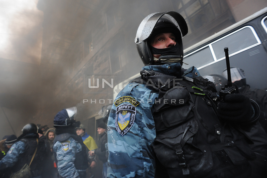 """Special riot police forces """"Berkut"""" during the failed assault on town hall. Kiev Ukraine.<br /> <br /> Protesters did not give up after the faint  attempt of evacuation performed by the police of the night before. Despite the adverse weather conditions,  they restored and rebuilt the complex structures of the  barricades under the snow in Maidan square. Kiev,  Ukraine."""