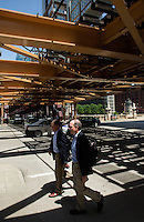01 JUL 2014 - CHICAGO, USA - Pedestrians cross the road under the tracks of the elevated train system, The L, at the Wells Street and West Wacker Drive junction in Chicago in the USA (PHOTO COPYRIGHT © 2014 NIGEL FARROW, ALL RIGHTS RESERVED)