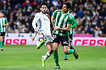 Isco Alarcon of Real Madrid competes for the ball with Alex Martinez of Real Betis during the match of Spanish La Liga between Real Madrid and Real Betis at  Santiago Bernabeu Stadium in Madrid, Spain. March 12, 2017. (ALTERPHOTOS / Rodrigo Jimenez)