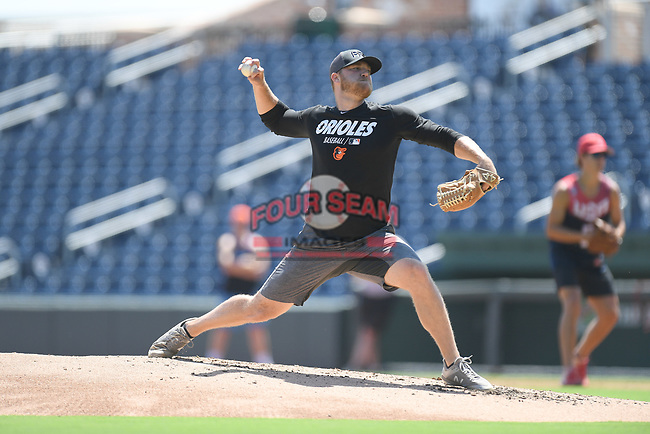 """Baltimore Orioles pitcher David Hess pitches in a """"Sandlot""""-style game concluding a series of workouts with local MLB and MiLB players from around the Upstate region on Thursday June 25, 2020, at Fluor Field at the West End in Greenville, South Carolina. (Tom Priddy/Four Seam Images)"""