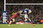 Wales center Jamie Roberts tackles French wing Yoann Huget.<br /> RBS 6 Nations 2014<br /> Wales v France<br /> Millennium Stadium<br /> 21.02.14<br /> <br /> ©Steve Pope-SPORTINGWALES
