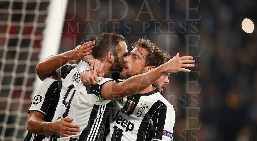 Calcio, Champions League: Gruppo H, Juventus vs Lione. Torino, Juventus Stadium, 2 novembre 2016. <br /> Juventus' Gonzalo Higuain, left, celebrates with teammates Claudio Marchisio, center, and Miralem Pjanic, after scoring on a penalty kick during the Champions League Group H football match between Juventus and Lyon at Turin's Juventus Stadium, 2 November 2016. The game ended 1-1.<br /> UPDATE IMAGES PRESS/Isabella Bonotto