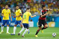 Sami Khedira of Germany skips past Oscar , Hulk and Fred of Brazil
