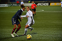 Lorient, France. - Sunday, February 8, 2015:  Laura Georges (4) of France and Christen Press (23) of the USWNT. France defeated the USWNT 2-0 during an international friendly at the Stade du Moustoir.
