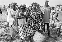 - women on the beach wait the return of the fishermen ....- donne sulla spiaggia aspettano il ritorno dei pescatori
