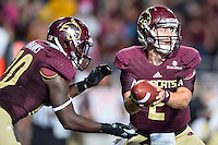 Texas State quarterback Tyler Jones (2) handoff to running back Terrence Franks (20) during second half of an NCAA Football game, Saturday, October 04, 2014 in San Marcos, Tex. Texas State defeated Idaho 35-30. (Mo Khursheed/TFV Media via AP Images)