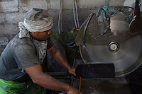 Bali, Indonesia.  Stonecutters at Work Cutting Stone for Making Religious Shrines.