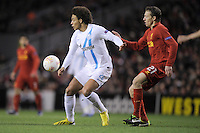 21.02.2013 Liverpool, England.Axel Witsel  of Zenit St Petersburg and Lucas of Liverpool  in action during the Europa League game between Liverpool and Zenit St Petersburg from Anfield.