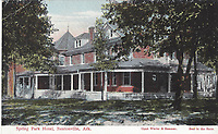 """Courtesy BV Historical Museum<br /> The Spring Park Hotel stood in Bentonville where the Park Springs Park is now located at 300 NW 10th Street, near the corner of Tiger Blvd. and NW """"A"""" Street.  By the late 1800s the area was already a place for the community to gather. After springs were discovered at the site, a hotel was built in the early 1900's with the name of Spring Park, although the site was also referred to as Park Springs, as it is named today. In 1920, the hotel was bought by George and Clara Crowder, who had moved to Bentonville from Kansas in 1913 to work and live at the Massey Hotel that had been built on the Bentonville square in 1910. They ran it untill Clara's death in 1924. Rev. William and Mary Baker began the building of a dam across Little Sugar Creek four miles north of Bentonville in 1915 to create a lake, and held a naming contest for the lake in the late 1915-early 1916 timeframe. Clara Crowder submitted the name """"Bella Vista"""", meaning 'beautiful view', and won the contest. The Bella Vista Summer Resort opened in 1917, the expanded Bella Vista Village was opened in 1965, and the present day City of Bella Vista was incorporated in 2007, all with the name that originated as """"Bella Vista"""" over 100 years ago. This postcard carries no message, but it postmarked Bentonville Ark, Oct. 22, 1907, and was mailed to Miss Lizzie Goodlander in Drakeville, Iowa."""