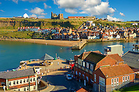 Whitby harbour looking towards Whitby Abbey . Whitby, North Yorkshire, England