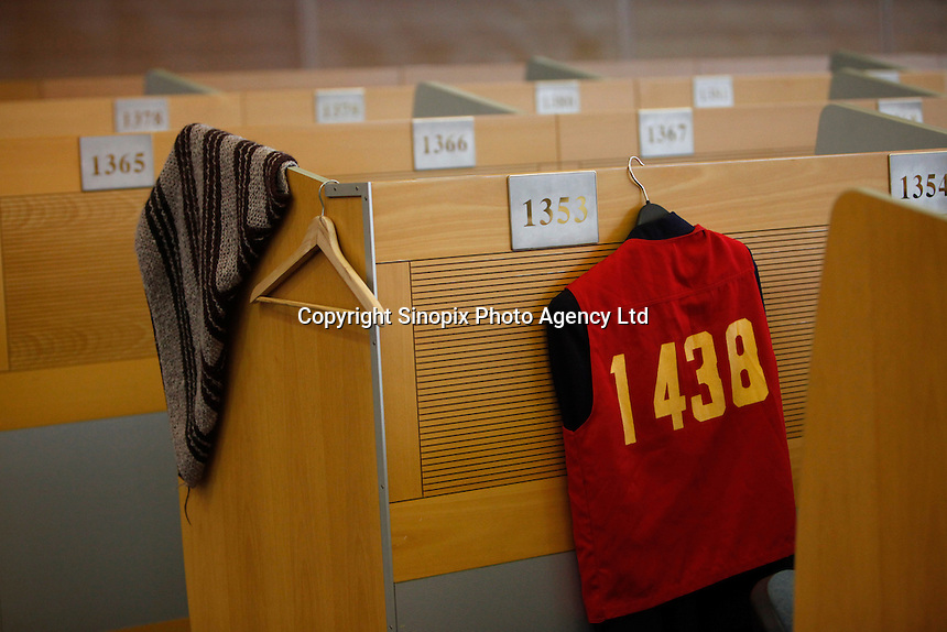 A trader's vest hang on a booth on the trading floor of the Shanghai Stock Exchange (SSE) in Shanghai, China. The Shanghai Stock Exchange is one of the three stock exchanges operating independently in the People's Republic of China, the other two are the Shenzhen Stock Exchange and the Hong Kong Stock Exchange. It is the world's sixth largest stock market by market capitalization at US$2.4 trillion as of Aug 2010..18 Aug 2010