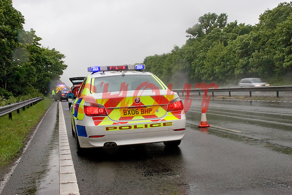 Police Car attends a RTC on the Motorway Warwickshire UK. This image may only be used to portray the subject in a positive manner..©shoutpictures.com..john@shoutpictures.com