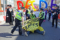 Pictured: Two anti-lesbian protesters disrupt the parade on the Kingsway infront of The Lord Mayor Councillor David Phillips (L). Saturday 04 May 2019<br /> Re: Swansea Pride Parade in south Wales, UK.