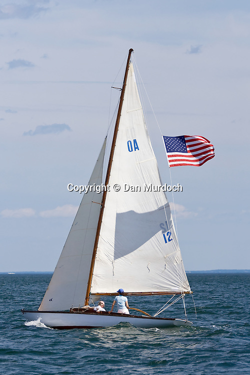 Classic sailboat with American flag in afternoon sail