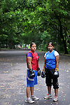 INDIA (West Bengal - Calcutta)July 2010, Shakila Babe(left) and Sanno Babe (right) during their practice in a local park. Shakila and Shanno are twins from a poor muslim family of Iqbalpur, Kolkata. . Inspite of their late father's unwillingness to send his daughters to take up  boxing her mother Banno Begum inspired them to take up boxing at the age of 3. Their father was more concerned about the social stigma they have in their community regarding women coming into sports or doing anything which may show disrespect to the religious emotions of his community. Shakila now has been recognised as one of the best young woman boxers of the country after she won the  international championship at Turkey in the junior category. Shanno is also been called for the National camp this year. Presently Shakila and shanno has become the role model in the Iqbalpur area  and parents from muslim community of Iqbalpur have started showing interst in boxing. Iqbalpur is a poor muslim dominated area mostly covered with shanty town with all odds which comes along with poverty and lack of education. - Arindam Mukherjee