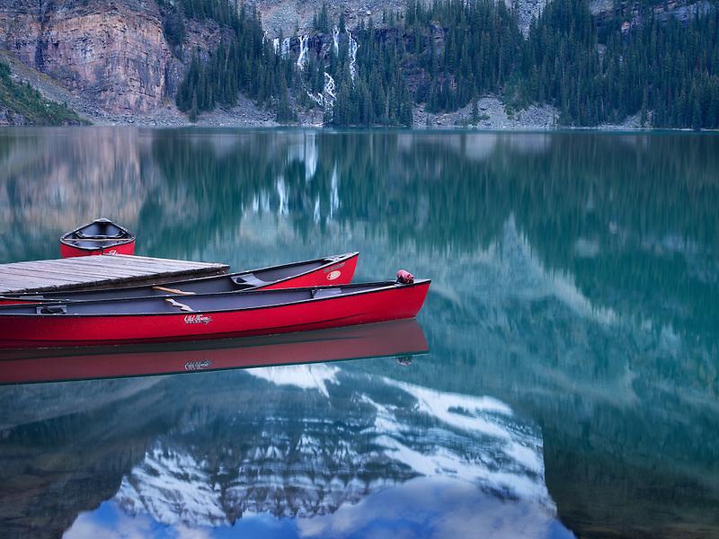 Lake O'hara with red canoes. Yoho National Park, Opabin Plateau, British Columbia, Canada