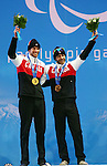 Sochi,Russia.11/03/2014. Canadian Brian Mckeever and his guide Erik Carleton celebrate their gold medals in the cross country skiing men's 20 km visually impaired at the Sochi 2014 Paralympic Winter Games in Sochi Russia.(Photo: Scott Grant/Canadian Paralympic Committee)