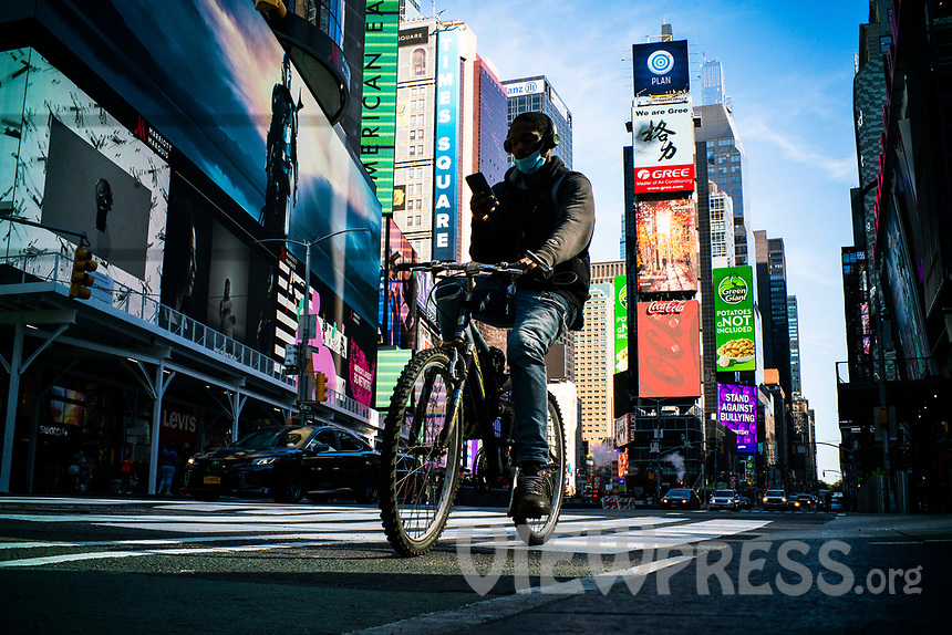 NEW YORK, NY - OCTOBER 15: A man rides a bike at Times Square on October 15, 2020 in New York, At least 4,477 bicycles have been reported stolen with an increase of 27 percent from same period last year, according to the police. (Photo by Eduardo MunozAlvarez/VIEWpress)