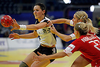 BELGRADE, SERBIA - DECEMBER 15:  Anna Punko of Russia (L) is challenged by Laerke Moller (R) of Denmark during the Women's European Handball Championship 2012 fifth place match between Denmark and Russia at Arena Hall on December 15, 2012 in Belgrade, Serbia. (Photo by Srdjan Stevanovic/Getty Images)