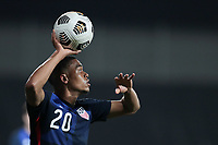 WIENER NEUSTADT, AUSTRIA - MARCH 25: Reggie Cannon #20 of the United States on a throw in during a game between Jamaica and USMNT at Stadion Wiener Neustadt on March 25, 2021 in Wiener Neustadt, Austria.