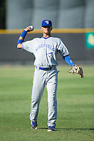 Andrew Florides (14) of the Bluefield Blue Jays warms up in the outfield prior to the game against the Burlington Royals at Burlington Athletic Stadium on June 26, 2016 in Burlington, North Carolina.  The Blue Jays defeated the Royals 4-3.  (Brian Westerholt/Four Seam Images)