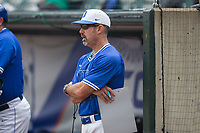 Duke Blue Devils head coach Chris Pollard watches the action from the dugout during the game against the Florida State Seminoles in the first semifinal of the 2017 ACC Baseball Championship at Louisville Slugger Field on May 27, 2017 in Louisville, Kentucky.  The Seminoles defeated the Blue Devils 5-1.  (Brian Westerholt/Four Seam Images)